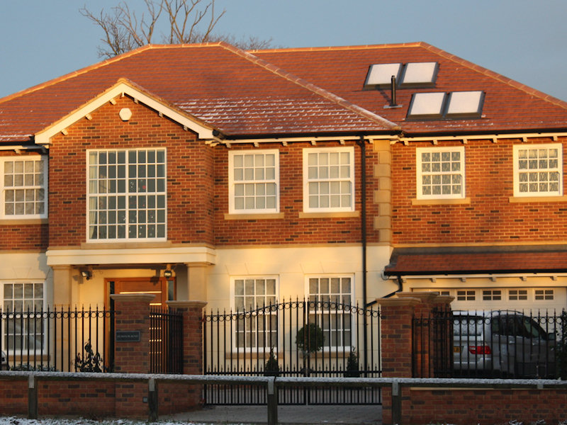 Home with hot water system powered by solar panels on the roof